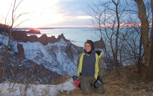 Sun sets on Lake Ontario behind spectacular Chimney Bluffs and the author.