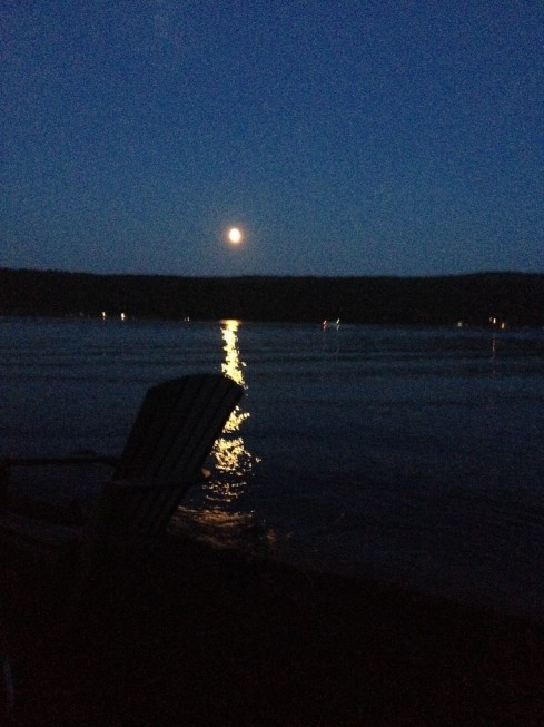 Keuka Lake becomes quiet as the full moon rises and night advances.