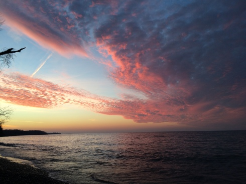 Pink skies and waters create stunning scenery over Lake Ontario in Huron, NY.
