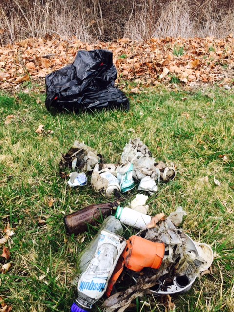 Trash collected includes many types of bottles, plastic and metal.