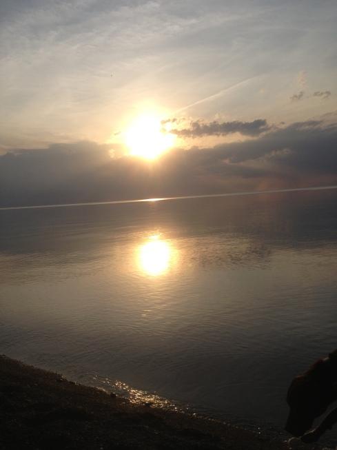 Sun Reflects on Flat Blue Water