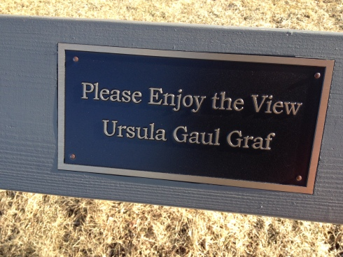 A brass nameplate shares Ursula Gaul Graf's wish for visitors to enjoy the view at Chimney Bluffs.