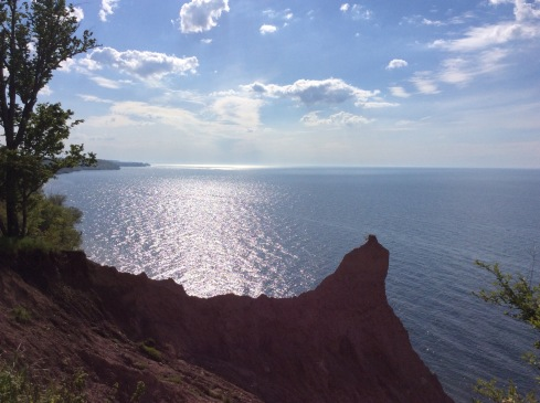 Sun shines over Lake Ontario from Scott's Bluffs